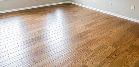 41678621 - a shiny, polished hardwood floor in a new home